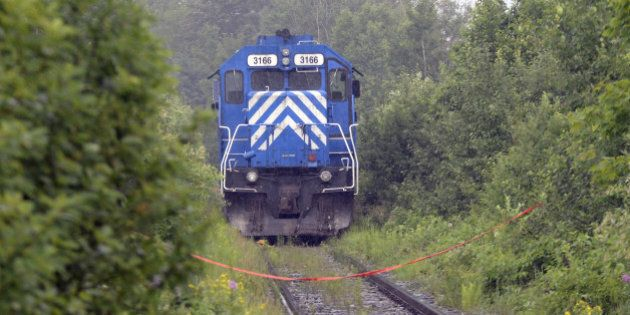 A train from the MMA (Montreal, Maine & Atlantic) railway is viewed as it was stopped by the RCMP and...