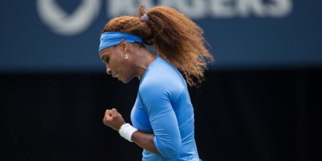 Serena Williams of the United States celebrates a point during the final of the Rogers Cup against Sorana Cirstea of Romania at Rexall Centre at York University in Toronto, Ontario, Canada on August 11, 2013. AFP PHOTO/Geoff Robins        (Photo credit should read GEOFF ROBINS/AFP/Getty Images)