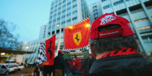 GRENOBLE, FRANCE - DECEMBER 31: Ferrari fans set up flags outside the Grenoble University Hospital Centre...