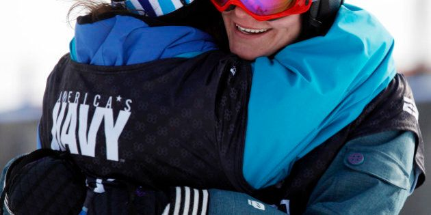 Kaya Turski, right, of Canada, is hugged after winning the skiing slopestyle women's final during the Winter X Games 14 at Buttermilk Mountain outside Aspen, Colo., on Thursday, Jan. 28, 2010. (AP Photo/David Zalubowski)