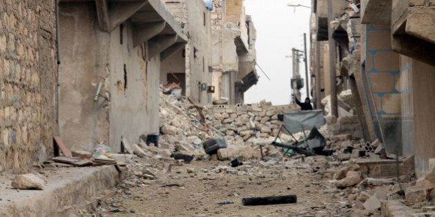 ALEPPO, SYRIA - JANUARY 25: Many houses are demolished and many others are damaged in a barrel bomb attack...