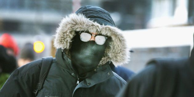 CHICAGO, IL - JANUARY 06: Commuters make a sub-zero trek to offices in the Loop on January 6, 2014 in...
