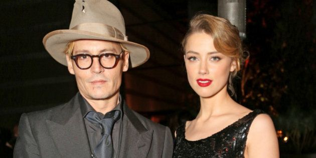 LOS ANGELES, CA - JANUARY 11: Actor Johnny Depp (L) and actress Amber Heard attend Perrier-Jouet Celebration...