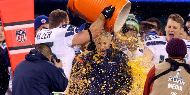 EAST RUTHERFORD, NJ - FEBRUARY 02: Tight end Zach Miller #86 of the Seattle Seahawks dumps Gatorade on...