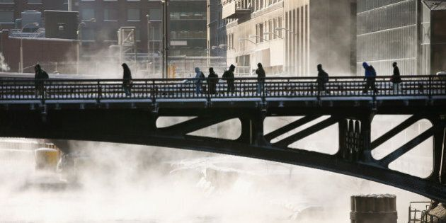 CHICAGO, IL - JANUARY 06: Commuters make their way across the Chicago River during a sub-zero trek to...