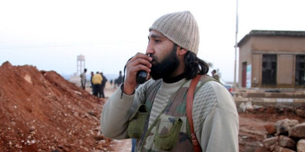 ALEPPO, SYRIA - JANUARY 4:  A man is seen during clashes between the Free Syrian Army (FSA) and the Islamic State of Syria and Al-Sham (or ISIS) on January 4, 2014 in Aleppo, Syria. (Photo by Salih Mahmud Leyla/Anadolu Agency/Getty Images)