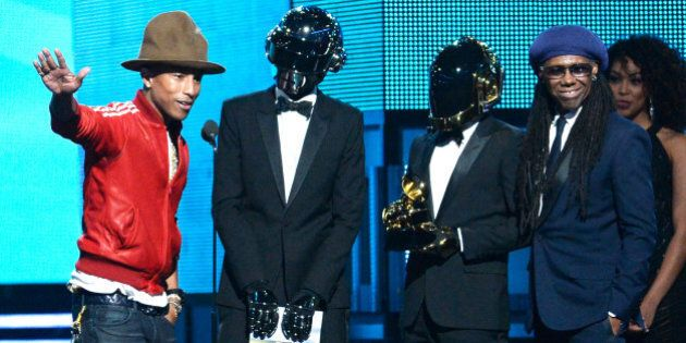 LOS ANGELES, CA - JANUARY 26: (L-R) Musicians Pharrell Williams, Thomas Bangalter and Guy-Manuel de Homem-Christo of Daft Punk, and Nile Rodgers accept the Best Pop Duo/Group Performance award for 'Get Lucky' onstage during the 56th GRAMMY Awards at Staples Center on January 26, 2014 in Los Angeles, California. (Photo by Kevork Djansezian/Getty Images)