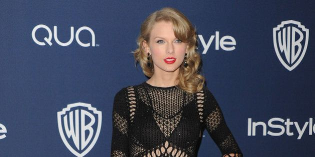 BEVERLY HILLS, CA - JANUARY 12: Singer Taylor Swift arrives at the 2014 InStyle And Warner Bros. 71st...