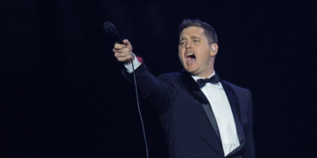 PRAGUE, CZECH REPUBLIC - JANUARY 24: Canadian singer and actor Michael Buble performs live on stage during a concert on the To Be Loved Tour at O2 Arena on January 24, 2014 in Prague, Czech Republic. (Photo by Radana Jenkins/isifa/Getty Images)