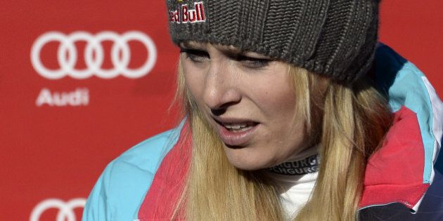 USA's Lindsey Vonn grimaces as she leaves after missing a gate while competing in the women's downhill race at the FIS Alpine Skiing World Cup in Val d'Isere in the French Alps on December 21, 2013. Vonn failed to put together a winning run for onlooking boyfriend Tiger Woods as her unstable right knee gave way halfway down the course. Vonn insisted the incident would not have major ramifications, saying she would race a maximum of two more events before heading to Sochi to defend her Olympic downhill title in February.        AFP PHOTO / FRANCK FIFE        (Photo credit should read FRANCK FIFE/AFP/Getty Images)