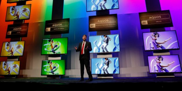 Jim Sanduski, senior vice president for strategic product marketing at Sharp Electronics Marketing Co. of America, speaks about the introduction of new 4K and HD Aquos televisions during a news conference at the 2014 Consumer Electronics Show (CES) in Las Vegas, Nevada, U.S., on Monday, Jan. 6, 2014. The CES trade show, which runs until Jan. 10, is the world's largest annual innovation event, offering an array of entrepreneur-focused exhibits, events, and conference sessions for technology entrepreneurs. Photographer: Patrick T. Fallon/Bloomberg via Getty Images