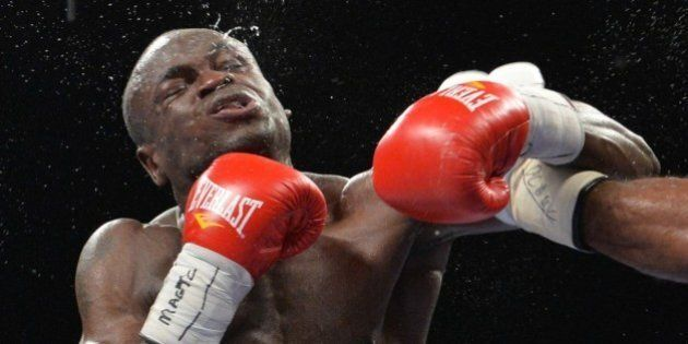 Haitian-born Canadian Dierry Jean (L) absorbs a left from US boxer Lamont Peterson (R) during their International...