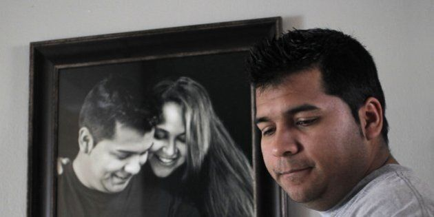 Erick Munoz, the husband of Marlise Machado Munoz, poses for a photo at his home on Jan. 3, 2014. Attorneys...