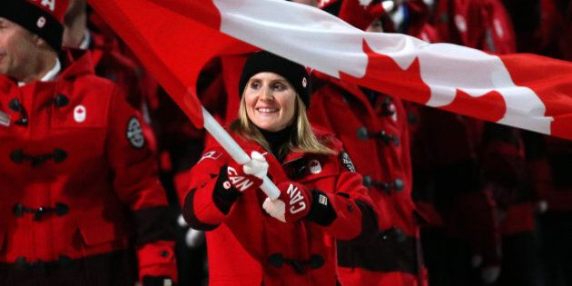 SOCHI, RUSSIA - FEBRUARY 7: Hayley Wickenheiser is the flag bearer for Canada during the Opening Ceremony...