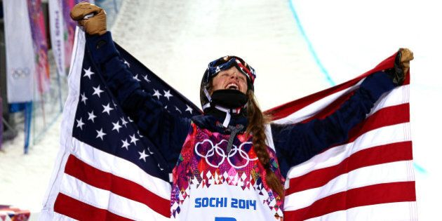 SOCHI, RUSSIA - FEBRUARY 20:  Maddie Bowman of the United States celebrates winning the gold medal in the Freestyle Skiing Ladies' Ski Halfpipe Finals on day thirteen of the 2014 Winter Olympics at Rosa Khutor Extreme Park on February 20, 2014 in Sochi, Russia.  (Photo by Cameron Spencer/Getty Images)