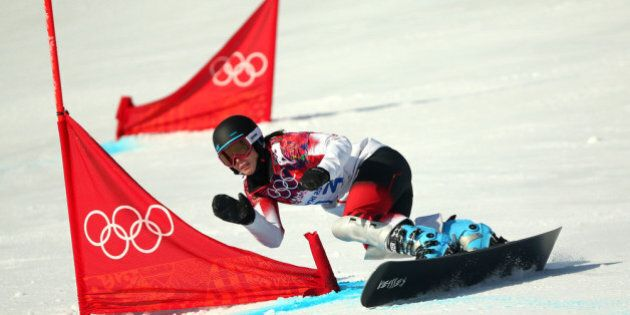 SOCHI, RUSSIA - FEBRUARY 19: Caroline Calve of Canada competes in the Snowboard Ladies' Parallel Giant...