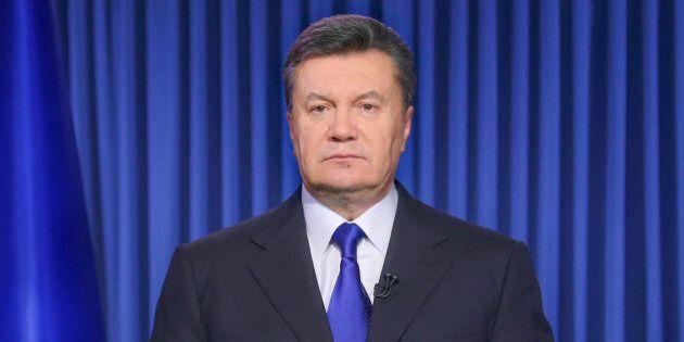 Ukrainian President Viktor Yanukovych addresses the nation on a live TV broadcast in Kiev, Ukraine, early...