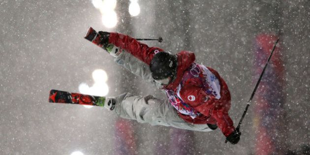 SOCHI, RUSSIA - FEBRUARY 18: Mike Riddle of Canada competes in the Freestyle Skiing Men's Ski Halfpipe...