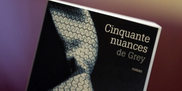 A picture taken on October 16, 2012 shows a copy of 'Fifty Shades of Grey' ('Cinquante nuances de Grey'...