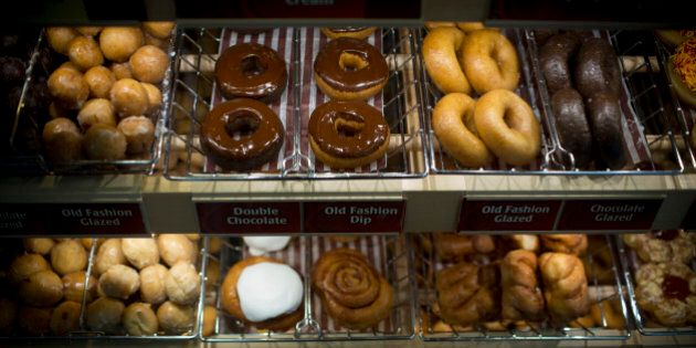 Doughnuts sit on display for sale at a Tim Hortons Inc. restaurant in Oakville, Ontario, Canada, on Monday,...
