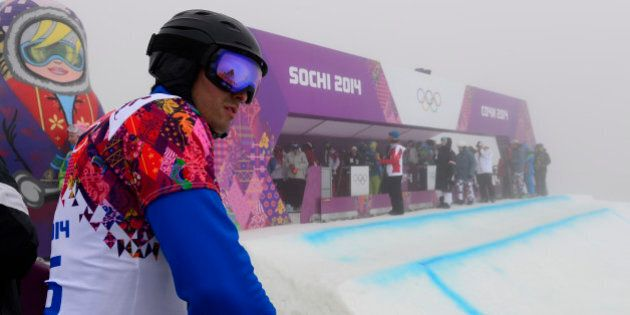 Andorra's Lluis Marin Tarroch looks at the slopes as athletes leave the Rosa Khutor Extreme Park after...