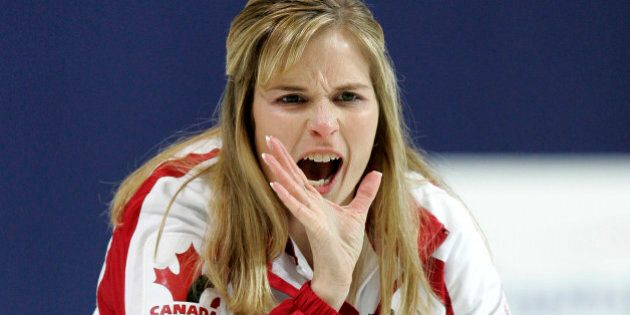 Canada's skip Jennifer Jones shouts instructions to her teammates during the World Women's Curling Championships...