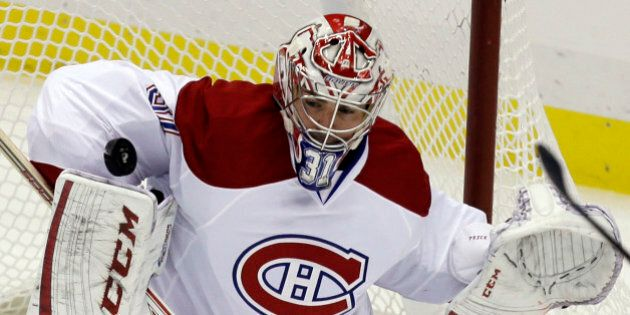 Montreal Canadiens goalie Carey Price (31) stops a shot against the Pittsburgh Penguins in the first...