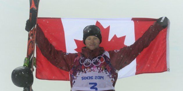 Silver Medallist, Canada's Mike Riddle celebrates at the Men's Freestyle Skiing Halfpipe Flower Ceremony...