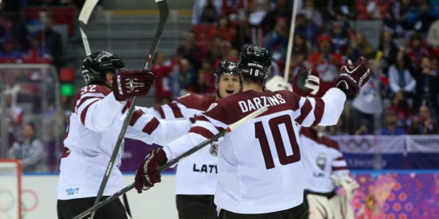 SOCHI, RUSSIA - FEBRUARY 18: Lauris Darzins #10 of Latvia celebrates an open net goal late in the third...