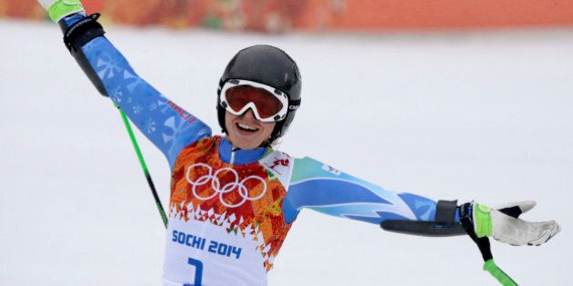 Slovenia's Tina Maze celebrates after taking the lead in the second run of the women's giant slalom at...