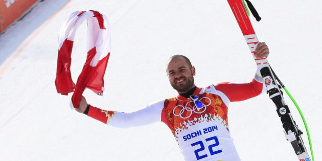Canada's Jan Hudec poses on the podium for the Men's Alpine Skiing Super-G Flower Ceremony at the Rosa...