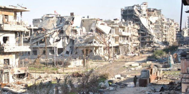 Civilians leave the the besieged district of the central Syrian city of Homs ahead of being evacuated...