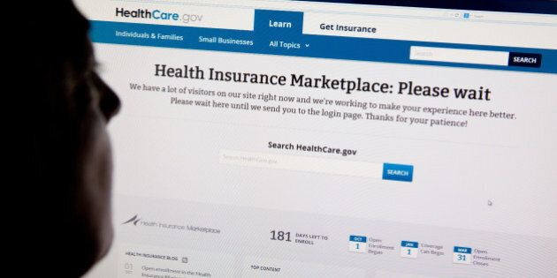 A woman looks at the HealthCare.gov insurance exchange internet site October 1, 2013 in Washington, DC....