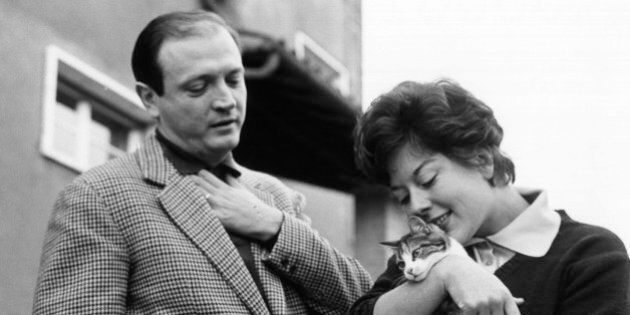 The actress Alba Arnova, holding a cat, and her husband Gianni Ferrio outside their new residence in...