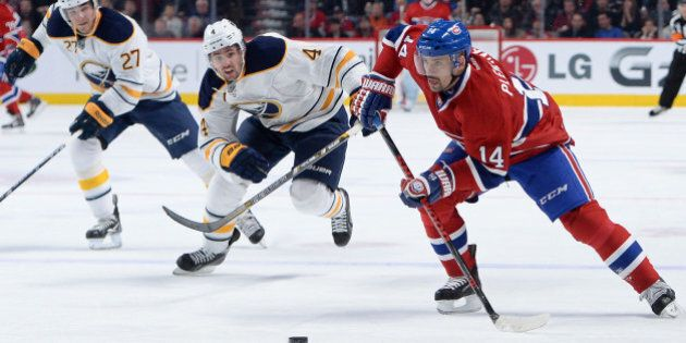 MONTREAL, QC - DECEMBER 7: Tomas Plekanec #14 of the Montreal Canadiens, controls the puck while being...