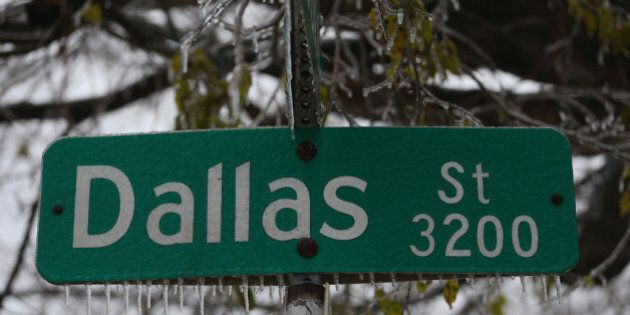 DALLAS, TX - DECEMBER 06: Icicles form on a Dallas street sign on December 6, 2013 in Dallas, Texas....