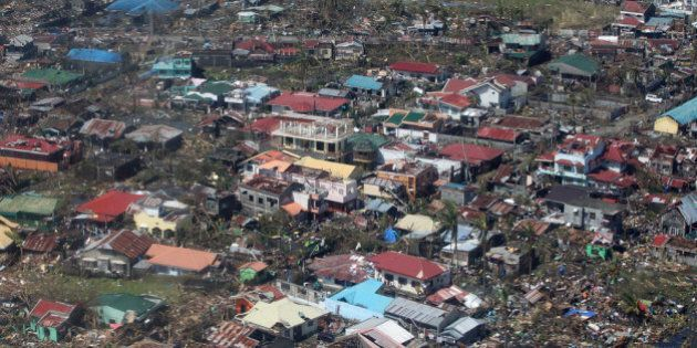 IN AIR, PHILIPPINES - NOVEMBER 10: In this handout from the Malacanang Photo Bureau, an aerial view of...
