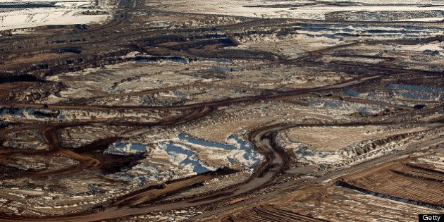 The Suncor Energy Inc. base plant is seen in this aerial photograph of the Athabasca Oil Sands near Fort...