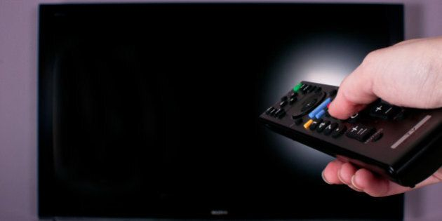hand holding remote control for