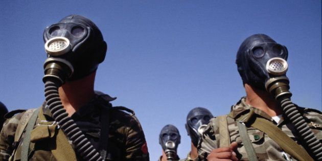 SAUDI ARABIA - MARCH 1990: Syrian troops photographed during a gas mask training exercise during the...