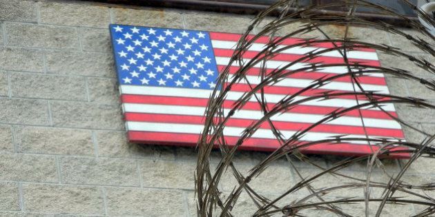 The US flag at the US Naval Base in Guantanamo Bay, Cuba on August 7, 2013. AFP PHOTO/CHANTAL VALERY...