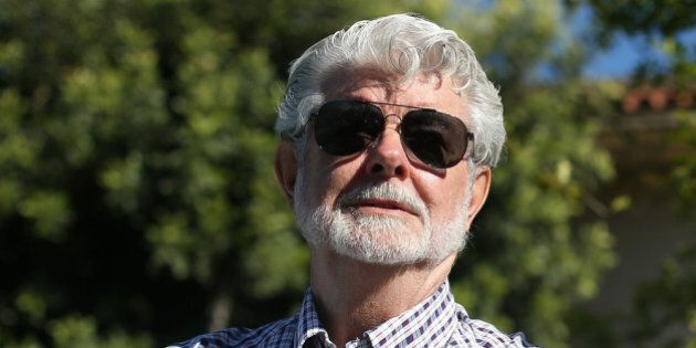 SAN ANSELMO, CA - JUNE 20: Film director George Lucas looks on during the unveiling of bronze statues...