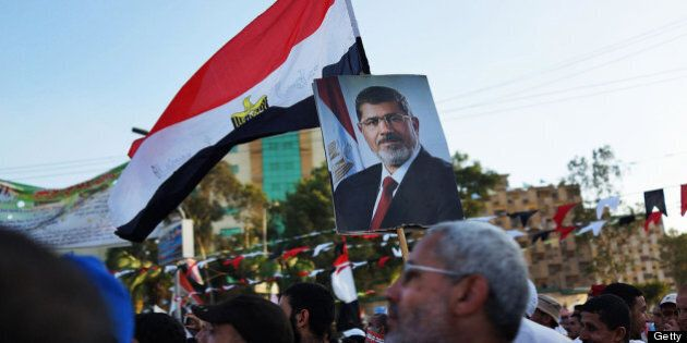 CAIRO, EGYPT - JULY 11: Supporters of ousted president Mohamed Morsi attend a rally before breaking the...