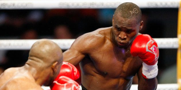 MONTREAL, CANADA - APRIL 8: Adonis Stevenson (R) punches Derek Edwards (L) during an undercard fight...