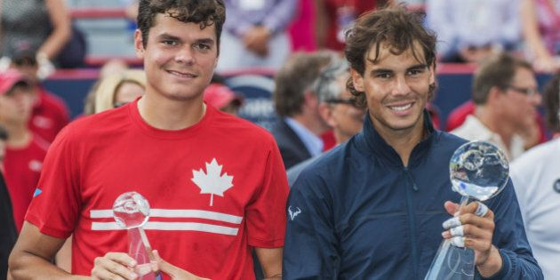 Milos Raonic of Canada (L) and Rafael Nadal of Spain (R) posing for the media after their final match at the Uniprix Stadium during the ATP Rogers Cup on August 11, 2013 in Montreal, Quebec, Canada. AFP PHOTO / ROGERIO BARBOSA        (Photo credit should read ROGERIO BARBOSA/AFP/Getty Images)