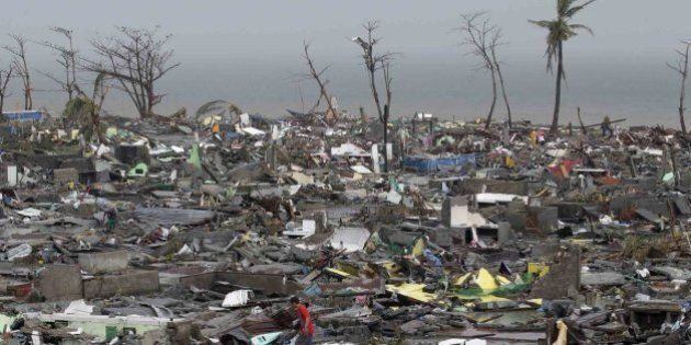 Destroyed houses lie in Tacloban city, Leyte province, central Philippines on Sunday, Nov. 10, 2013....
