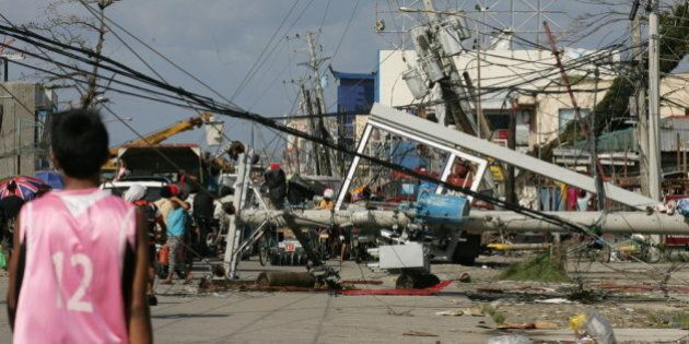 TACLOBAN, PHILIPPINES - NOVEMBER 10: Downed power lines and debris block the road in the aftermath of...