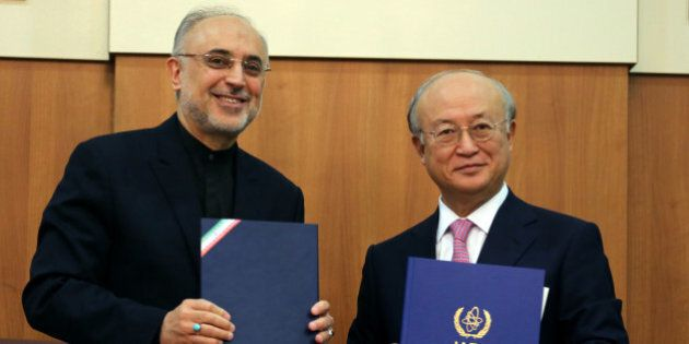 Head of Iran's Atomic Energy Organisation Ali Akbar Salehi (L) and International Atomic Energy Agency (IAEA) Director General Yukiya Amano, pose for a photo following their meeting in Tehran on November 11, 2013. Amano arrived in the Iranian capital to discuss Iran's nuclear programme after top world diplomats fail to clinch a long-sought deal to curb Tehran's nuclear activities but insist they are narrowing the gaps. AFP PHOTO/ATTA KENARE        (Photo credit should read ATTA KENARE/AFP/Getty Images)