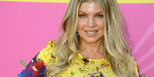 LOS ANGELES, CA - MARCH 23: Singer Fergie arrives at Nickelodeon's 26th Annual Kids' Choice Awards at...