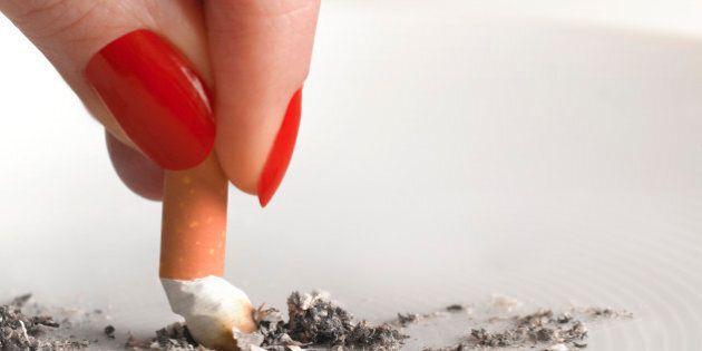 Woman stubbing out cigarette